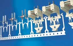 Anlagen zum Umspritzen von Bauteilen mit Kunststoff